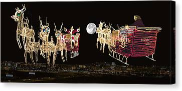 Santa Coming And Going Canvas Print by Thomas Woolworth