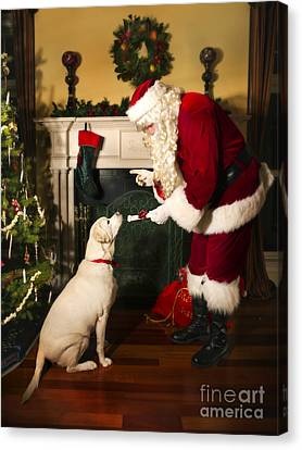 Santa Giving The Dog A Gift Canvas Print by Diane Diederich