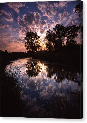 Scattered Sunrise Canvas Print by Ray Mathis