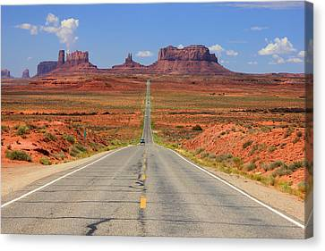 Scenic Road Into Monument Valley Canvas Print by Johnny Adolphson