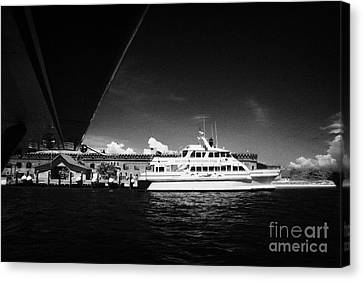 Seaplane Passing Ferry And Dock At Fort Jefferson Dry Tortugas National Park Florida Keys Usa Canvas Print by Joe Fox