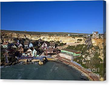 Seaside Village, Malta Canvas Print by Tim Holt