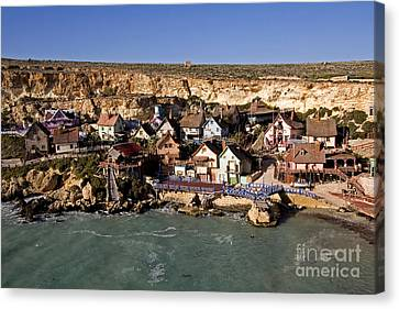 Seaside Village Under The Cliffs Canvas Print by Tim Holt