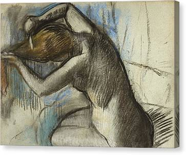Seated Nude Woman Brushing Her Hair Canvas Print by Edgar Degas