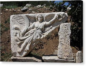 Stone Carving Of The Godness Nike Canvas Print by Christiane Schulze Art And Photography