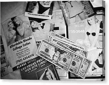 Selection Of Leaflets Advertising Girls Laid Out On A Hotel Bed With Us Dollars Cash In An Envelope  Canvas Print by Joe Fox