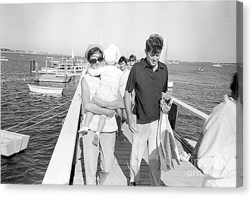 Senator John F. Kennedy And Jacqueline Kennedy At Hyannis Port Marina Canvas Print by The Phillip Harrington Collection