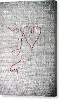 Sewing A Heart Canvas Print by Joana Kruse