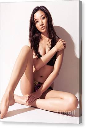 Sexy Asian Woman In Bikini Sitting Against White Wall Canvas Print by Oleksiy Maksymenko