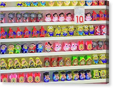 Shelves Of Children Toys, Shops Canvas Print by Stuart Westmorland