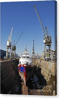 Ship Being Repaint In Dry Dock Canvas Print by Sami Sarkis