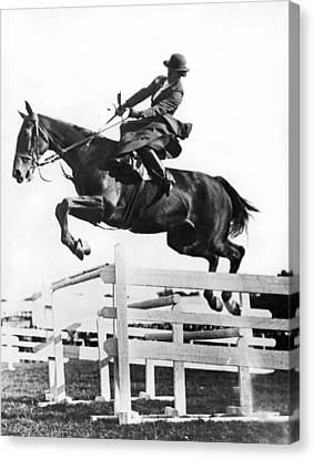Sidesaddle Jumps At Horse Show Canvas Print by Underwood Archives