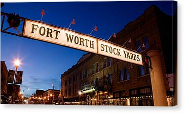 Signboard Over A Road At Dusk, Fort Canvas Print by Panoramic Images