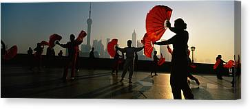 Silhouette Of A Group Of People Dancing Canvas Print by Panoramic Images