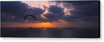 Silhouette Of A Person Paragliding Canvas Print by Panoramic Images