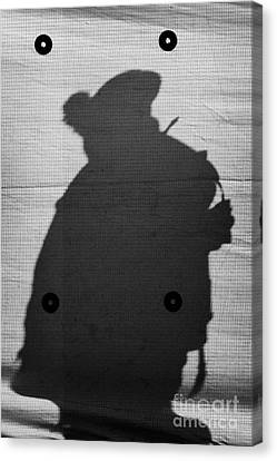 Silhouette Of British Army Soldier On Screen On Crumlin Road At Ardoyne Shops Belfast 12th July Canvas Print by Joe Fox