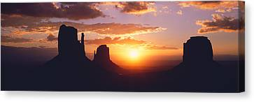 Silhouette Of Buttes At Sunset, The Canvas Print by Panoramic Images