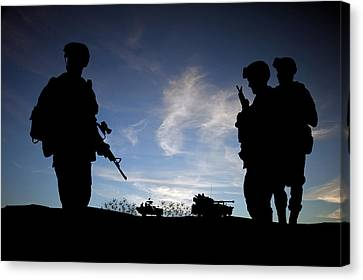 Silhouette Of Modern Soldiers  Canvas Print by Matthew Gibson