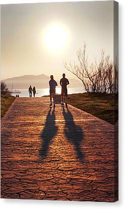 Silhouette Of People Jogging And Walking Canvas Print by Mikel Martinez de Osaba