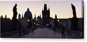 Silhouette Of Statues On Charles Bridge Canvas Print by Panoramic Images