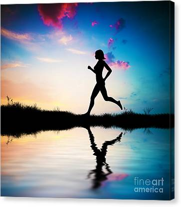 Silhouette Of Woman Running At Sunset Canvas Print by Michal Bednarek