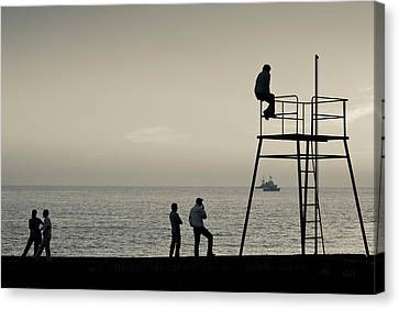 Silhouette People On Pier At Sunset Canvas Print by Panoramic Images
