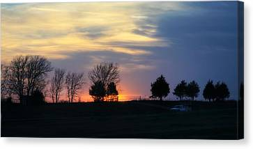 Silhouetts Of A Sunset Canvas Print by Joan Bertucci