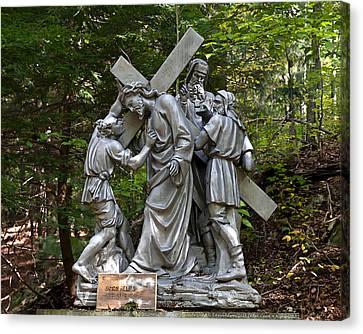 Simon Helps Jesus Canvas Print by Terry Reynoldson
