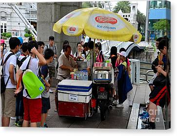 Singapore Ice Cream Man And Bicycle Swamped By Students Canvas Print by Imran Ahmed