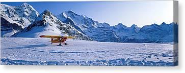 Ski Plane Mannlichen Switzerland Canvas Print by Panoramic Images