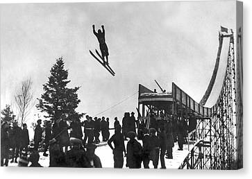 Skier Off A Jump Canvas Print by Underwood Archives