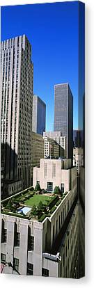 Skyscrapers In A City, Roof Garden Canvas Print by Panoramic Images
