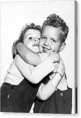 Small Boy Hugging His Sister Canvas Print by Ed Estabrook
