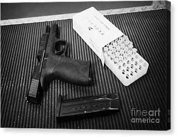 Smith And Wesson 9mm Handgun With Ammunition At A Gun Range Canvas Print by Joe Fox