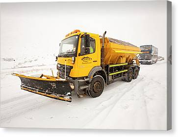 Snow Plough On The Road Canvas Print by Ashley Cooper