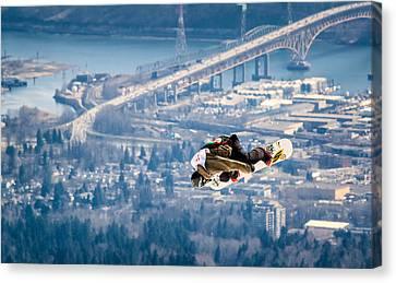 Snowboarding Over The City Canvas Print by Alexis Birkill