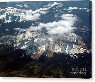 Snowcapped Mountains Canvas Print by Eva Kato