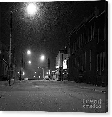 Snowing On W. Fourth St. Canvas Print by Julie Dant