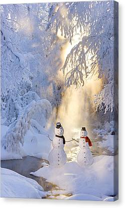 Snowman Couple Standing Next Canvas Print by Kevin Smith
