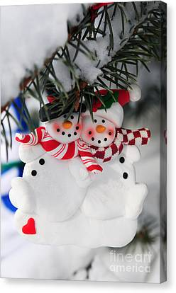 Snowmen Christmas Ornament Canvas Print by Elena Elisseeva