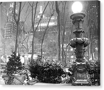 Snowy Night In Bryant Park II Canvas Print by Miriam Cintron