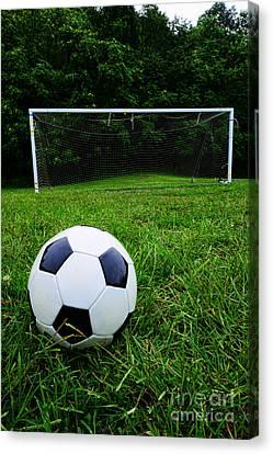 Soccer Ball On Field Canvas Print by Paul Ward