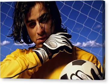 Soccer Goalkeeper In Net Canvas Print by Don Hammond