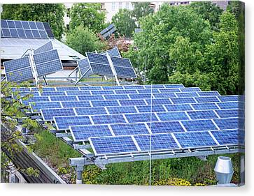 Solar Panels On Green Roof Canvas Print by Louise Murray