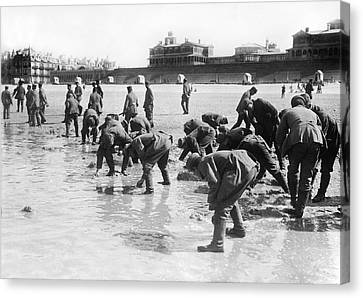 Soldiers Collecting Seashells Canvas Print by Underwood Archives