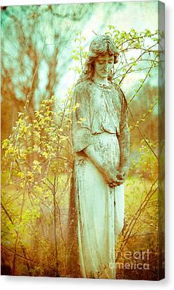 Solemn Cemetery Statue Canvas Print by Sonja Quintero