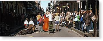 Spectator Looking At Street Musician Canvas Print by Panoramic Images