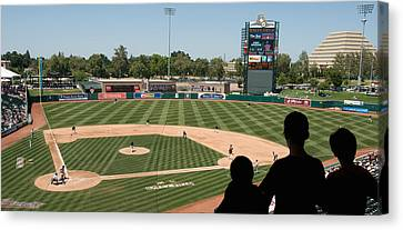 Spectator Watching A Baseball Match Canvas Print by Panoramic Images