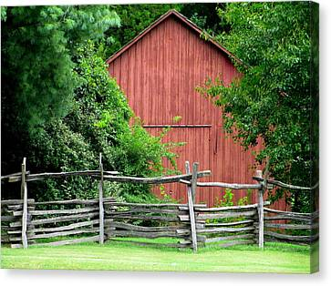 Split Rail Fence And Barn In Old Salem Canvas Print by Randall Weidner