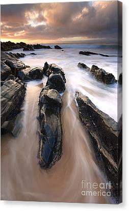 Splitting The Rocks Canvas Print by Mike  Dawson